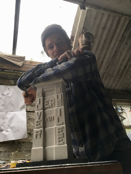 Taff's Well stonemason and carver Josh Underwood takes a break from his Portland stone made reproduction of the Walnut Tree Viaduct tower.