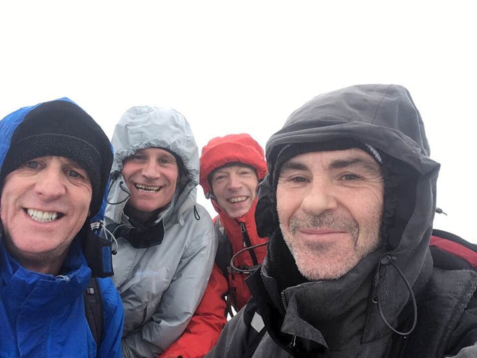 Trying to smile when it's flipping freezing at the top of Snowdon