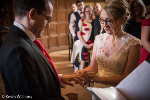 Exchanging wedding rings at St. Fagans Castle