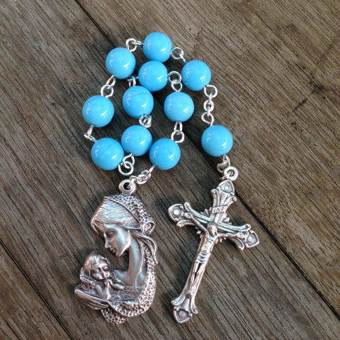 Blue pocket rosary with mother and child medal