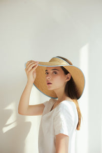 Summer flat raffia hat for vacation