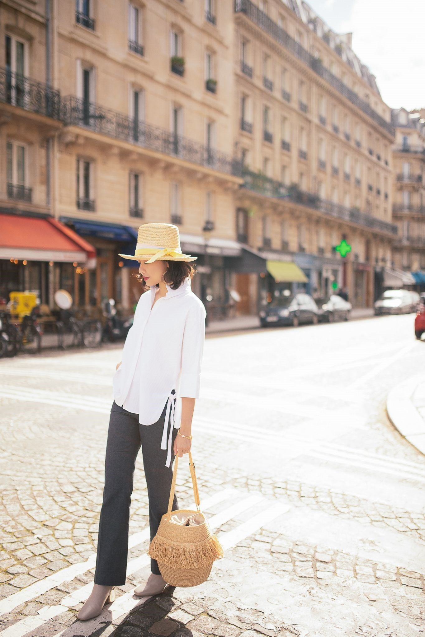 Mimi-Minh Nguyen in Paris with bucket Simon mini and Modernist hat, photo by Anh Huy Pham