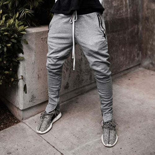 Fashion Solid Color Tie Zipper Pocket Feet Casual Pants