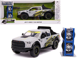 "2017 Ford F-150 Raptor Pickup Truck \Addictive Desert Designs"" Gray with Extra Wheels \""Just Trucks\"" Series 1/24 Diecast Model Car by Jada"""