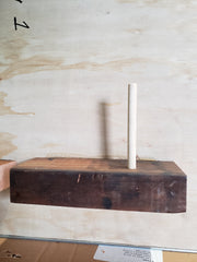 Insert wooden dowels thru holes located underneath the metal tabletop