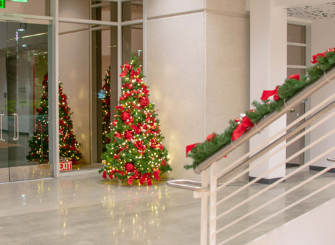 commercial property building office park lighting holiday christmas decoration installations outdoor indoor interior garland trees wreaths lighting ball ornaments