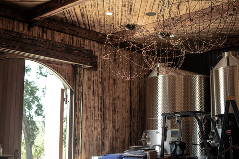 Installation of Lee Display's Hanging Spheres for the Hill Family Winery's newest tasting experience