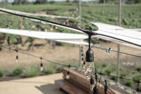 Installation of Lee Display's Vintage Patio Lights for the Hill Family Winery's newest tasting experience