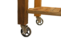 Lock the brakes on 2 of the wheels to stop the shelf from moving before lifting the top section into place