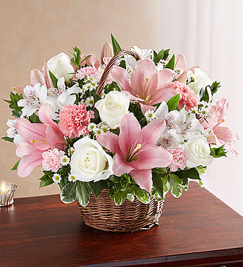 The pure white roses and the soft pinks make a lovely gift.  Lilies, carnations, alstroemeria, and more.