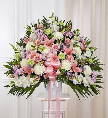 beautiful pastel standing basket with fresh roses, lilies, snapdragons