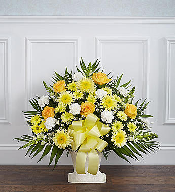 The basket includes: yellow roses, white mums, yellow lilies, white carnations, and a beautiful yellow ribbon.