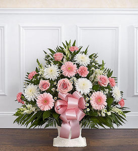 This beautiful sympathy basket comes with pink roses, pink gerbera daisies, white mums, pink bow and more.