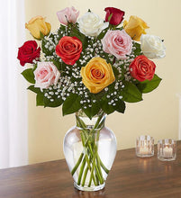 A dozen of our most spectacular assortment of roses, with greens and filler beautifully arranged in a vase