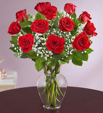 Our classic gift of love and romance. A dozen of our best long stemmed roses, filler, and greens, beautifully arranged and hand delivered for that special someone in your life.