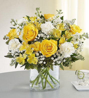cylinder vase, yellow roses, white carnations, yellow alstroemeria, baby's breath