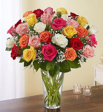 An assortment of roses, with greens and filler beautifully arranged in a vase