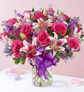 beautiful arrangement of pink roses, stargazer lilies, lavender stock, purple monte casino