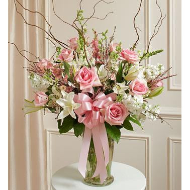 vase filled with pink roses, snapdragons, white lilies and more can be sent for any occasion.