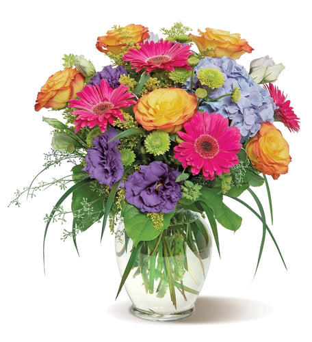 a bouquet that has blossoms in all the colors of the rainbow.