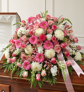 Traditionally sent by the immediate family to the funeral home. Our florists use only the freshest flowers available, so colors and and varieties may vary.