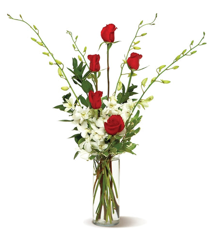 Give someone the gift of style – send this tall, slim arrangement of deered roses and white orchids, simply arranged in a clear glass vase