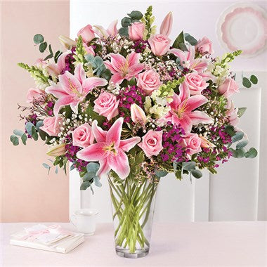 A vase designed to wow! An arrangement hand created with pink roses, lavish stargazer lilies and so much more.