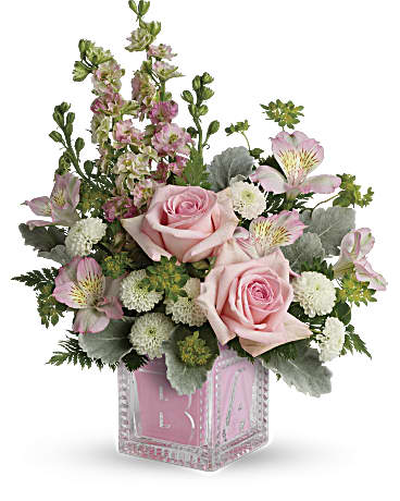 Celebrate a new life with this luxurious bouquet of roses, mums and delphinium, white alstroemeria,  button spray chrysanthemums, arranged with bupleurum, dusty miller, and leatherleaf fern in a darling glass baby block keepsake cube.