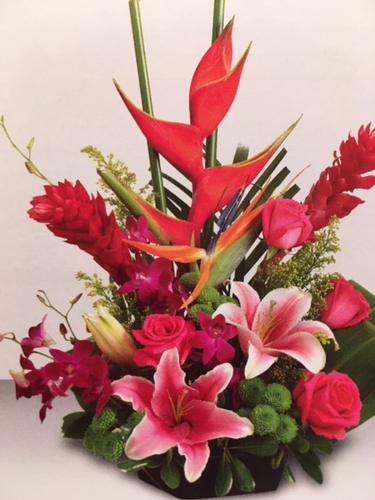 An arrangement that will be unforgettable with it's elegance and charm.  A paradise of brilliant flowers of ginger, orchids, birds of paradise, roses, lilies and more.