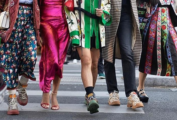 Paris Fashion Week Street Style shot of womens legs in different shoes