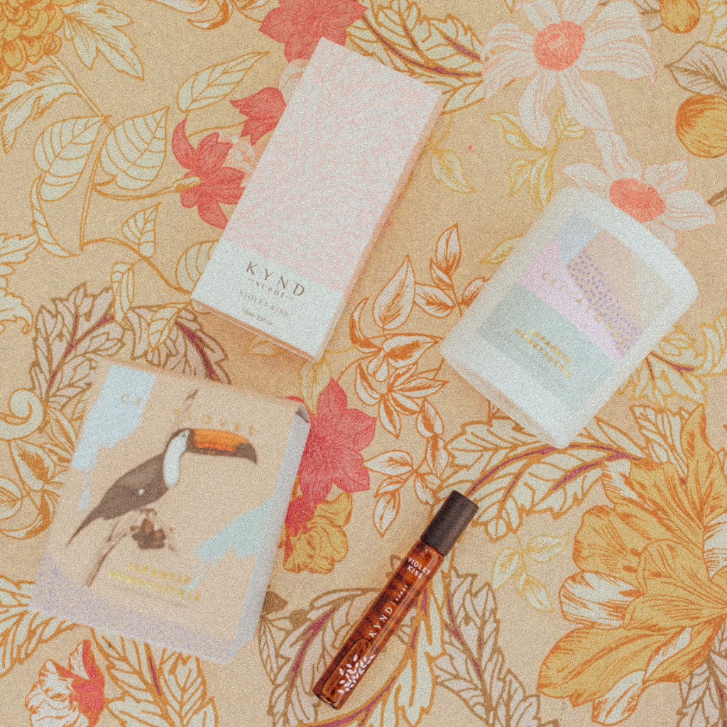 Kynd Scent & Celia Loves Candle on patterned background