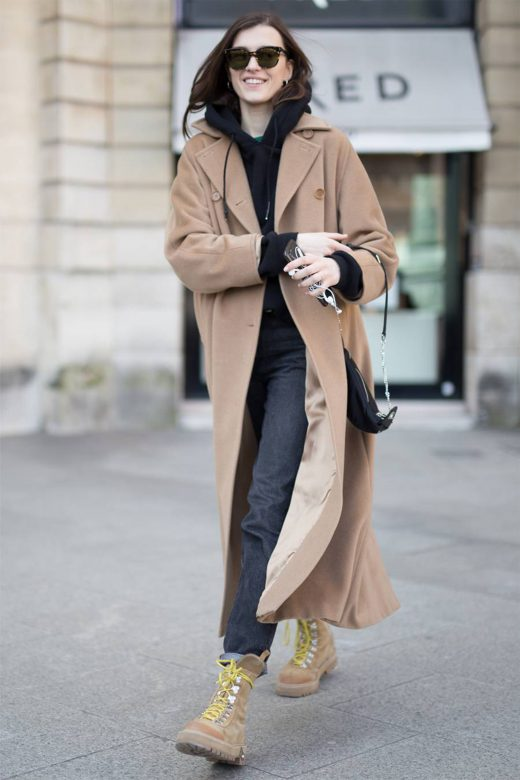 Street Style Photo of Woman in long camel trench with jeans and Camel Hiking Boots