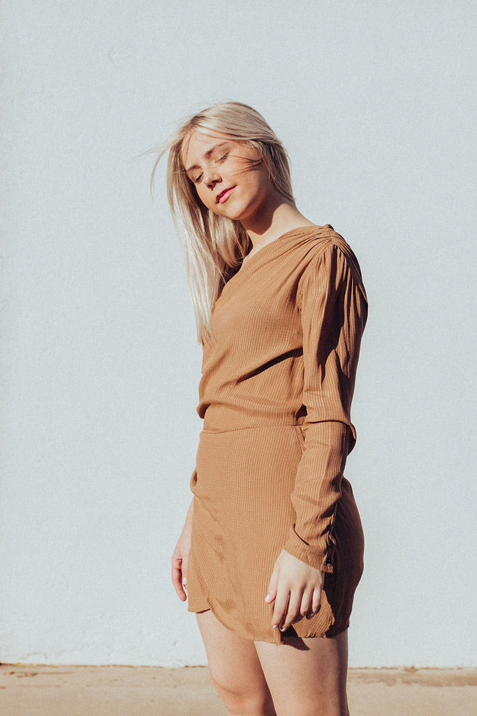 Abby up close in one shoulder dress by Rue Stiic