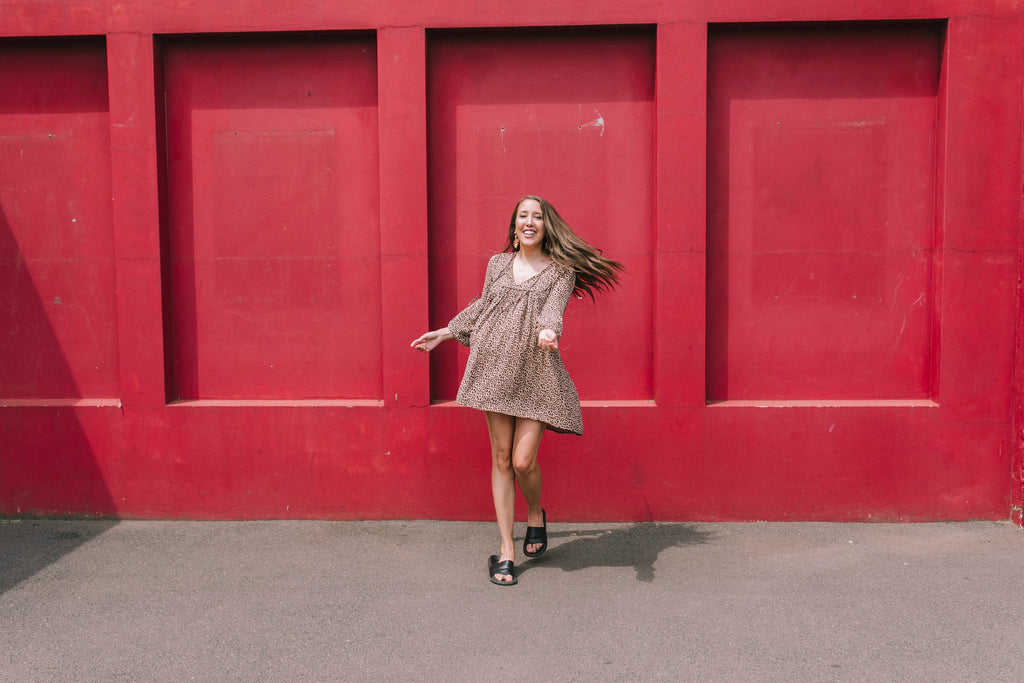 Picture of Libby with red wall image peppermint studios