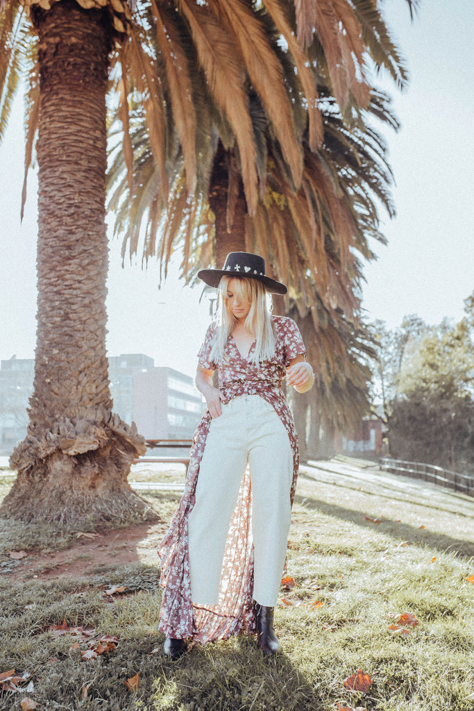 Model wearing the Auguste the label Matilda Fleur Wrap Maxi dress in brown floral & Outland Denim Ecru jean | Kindly, Darling