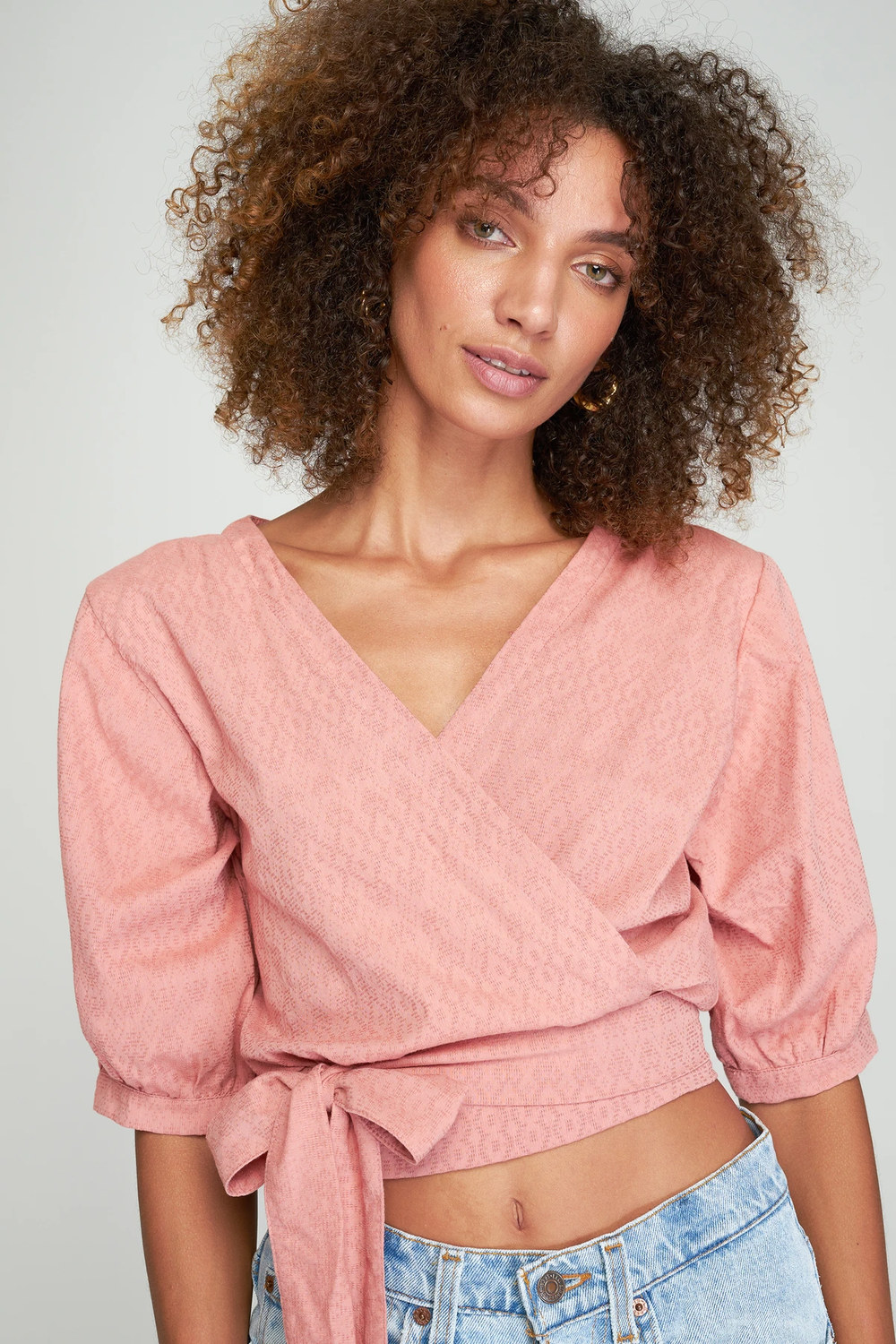 Aurora Wrap Top by Rue Stiic up close on model