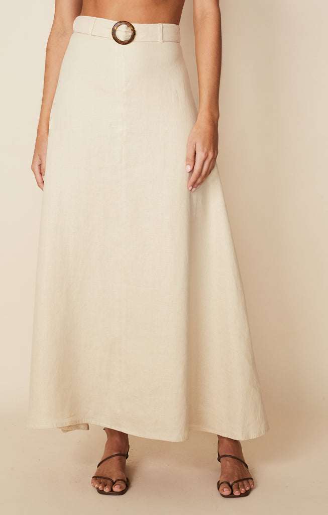 Up close front view of model wearing Devon Midi Skirt in Cream linen by Faithful the Brand