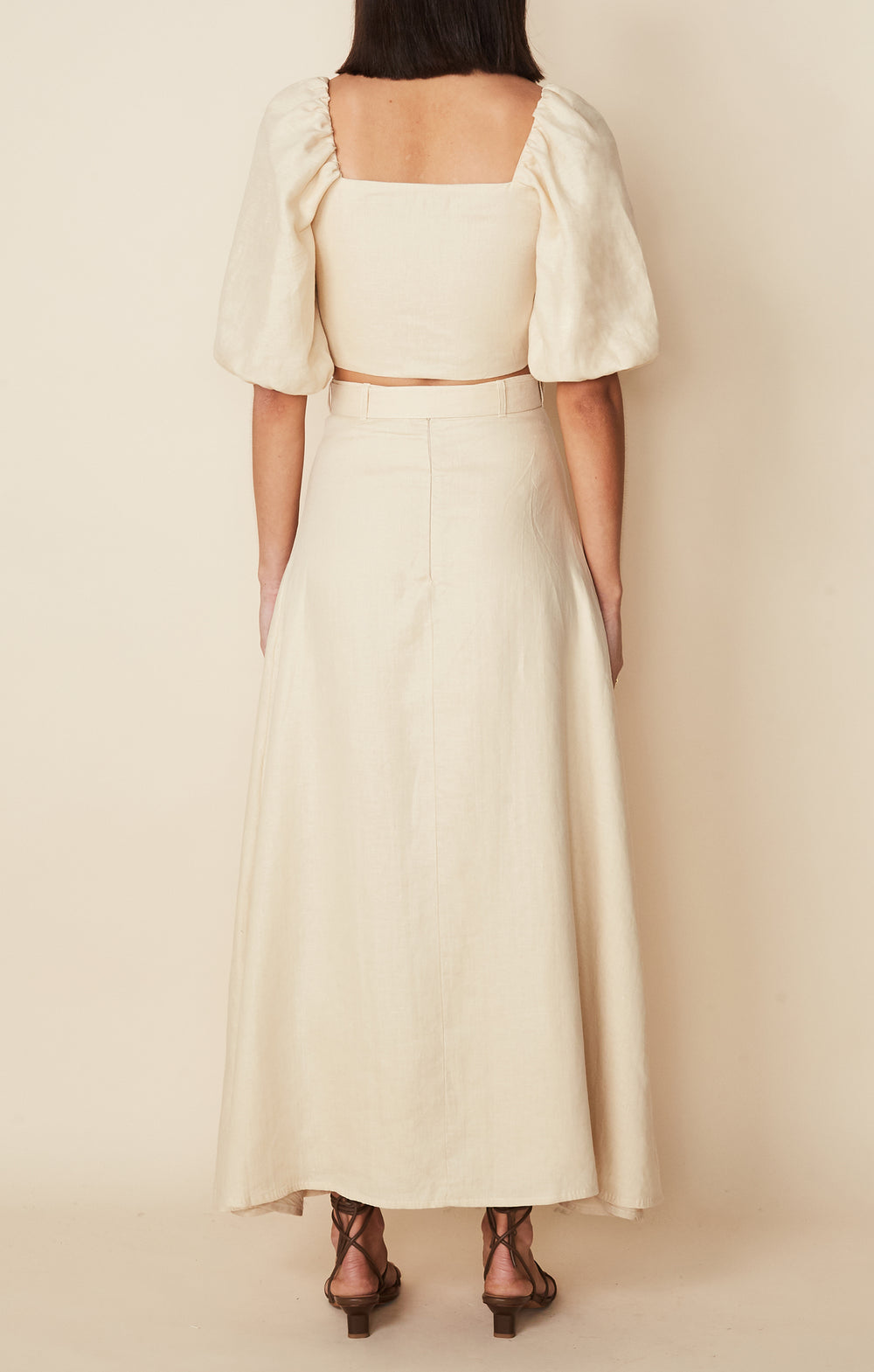 Full Length back view of model wearing Devon Midi Skirt in cream linen by Faithful the Brand