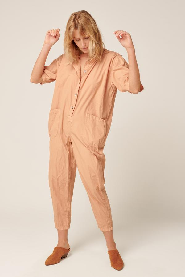 front view of model wearing the Primness Goppi Jumpsuit in Peached