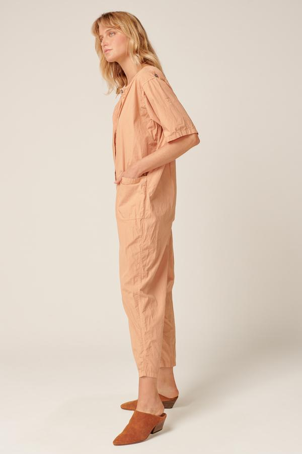 Side view of the Primness Goppi Jumpsuit in Peached