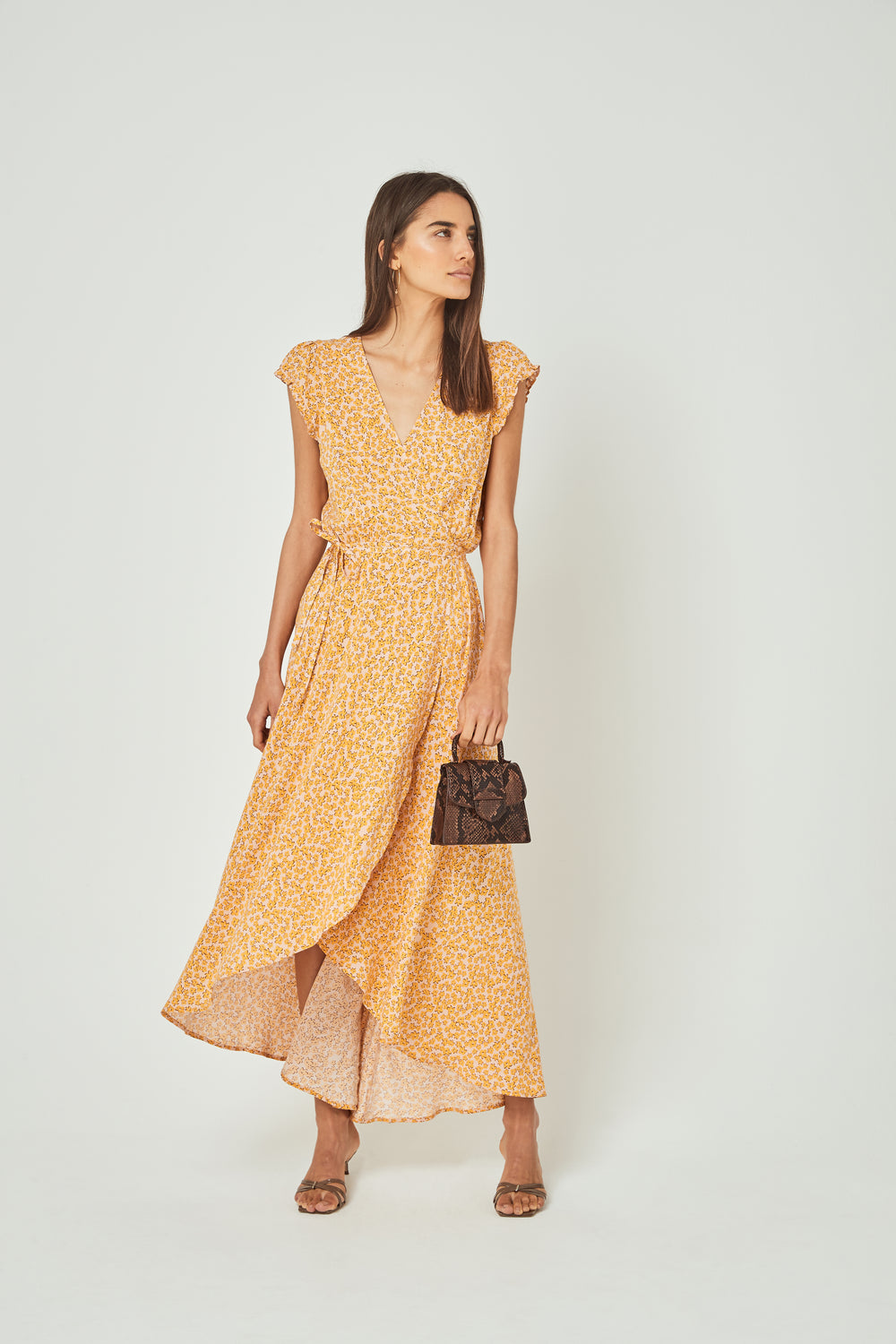 Showing the floaty fabric front view of the Auguste Dean Sierra Wrap Maxi Dress in Yellow