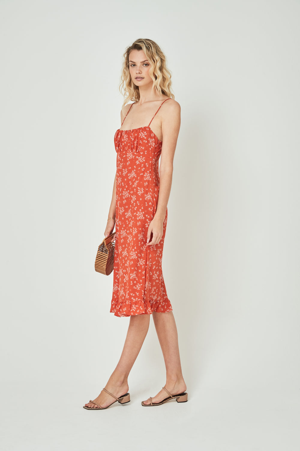 side view of woman wearing the Auguste - Meave Davis Midi Dress in Orange