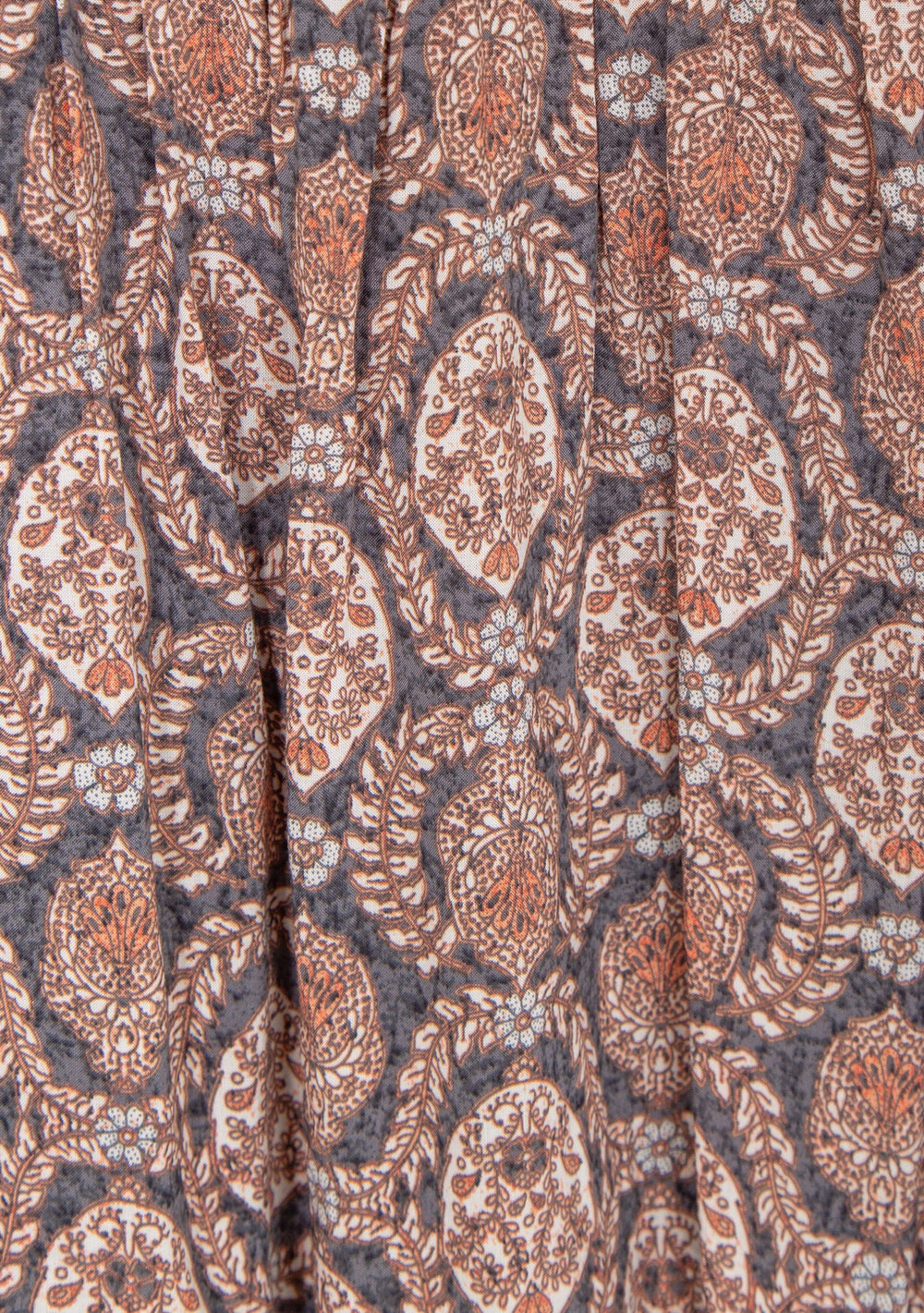 Close up of the Paisley Fabric on the Auguste Montague Bennett Shirred Midi Dress in Ink