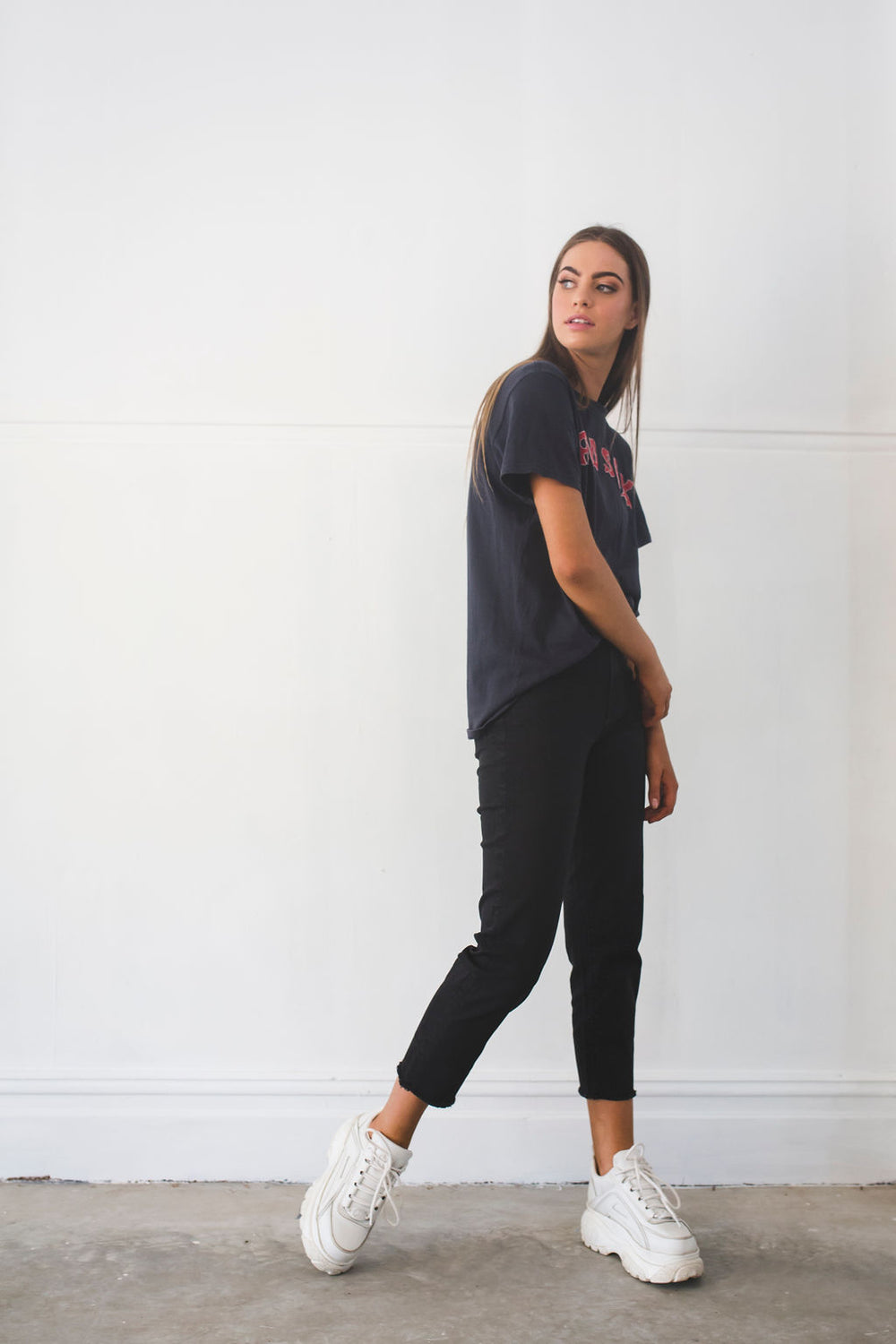Side view of the Outland Denim Black Crop Jean