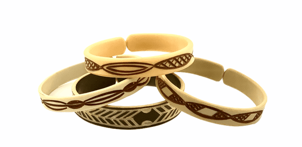 Northern Namibia Himba tribe hand carved and dyed cuffs from upcycled water pipe