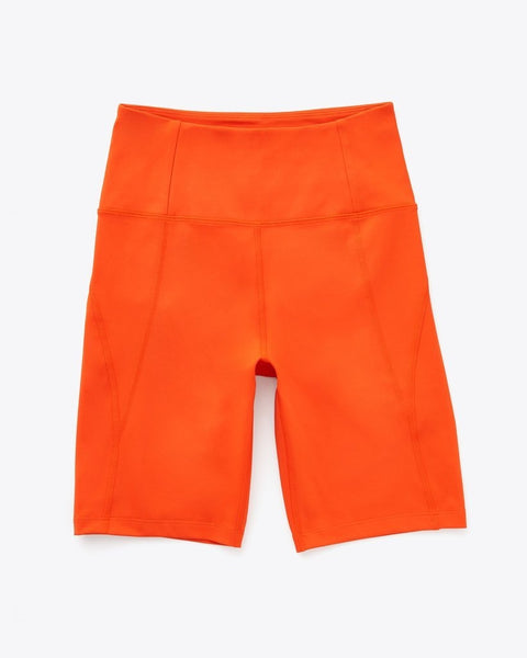 a flat lay of a pair of orange bike shorts