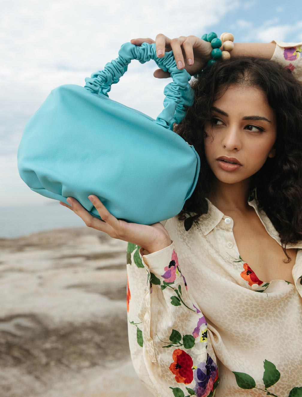 Shop women's designer bags at Camargue.