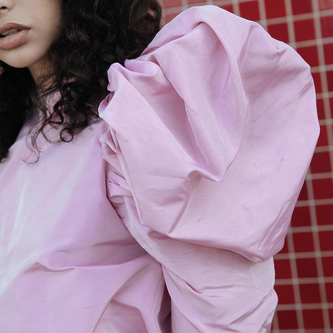 Nackiye's exaggerated sleeve in a standout, candy pink hue.