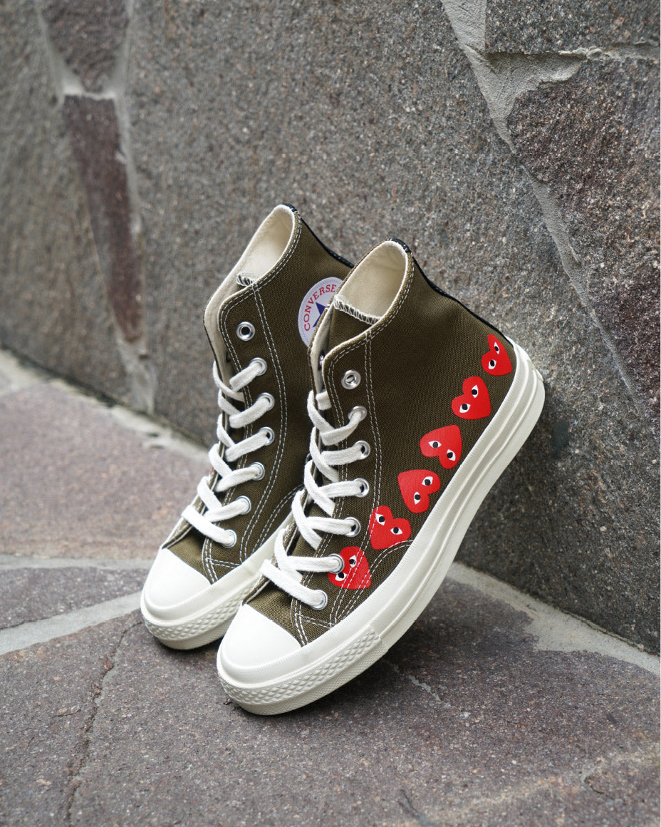 Shop Comme des Garçons PLAY X Converse sneakers in store & online now.