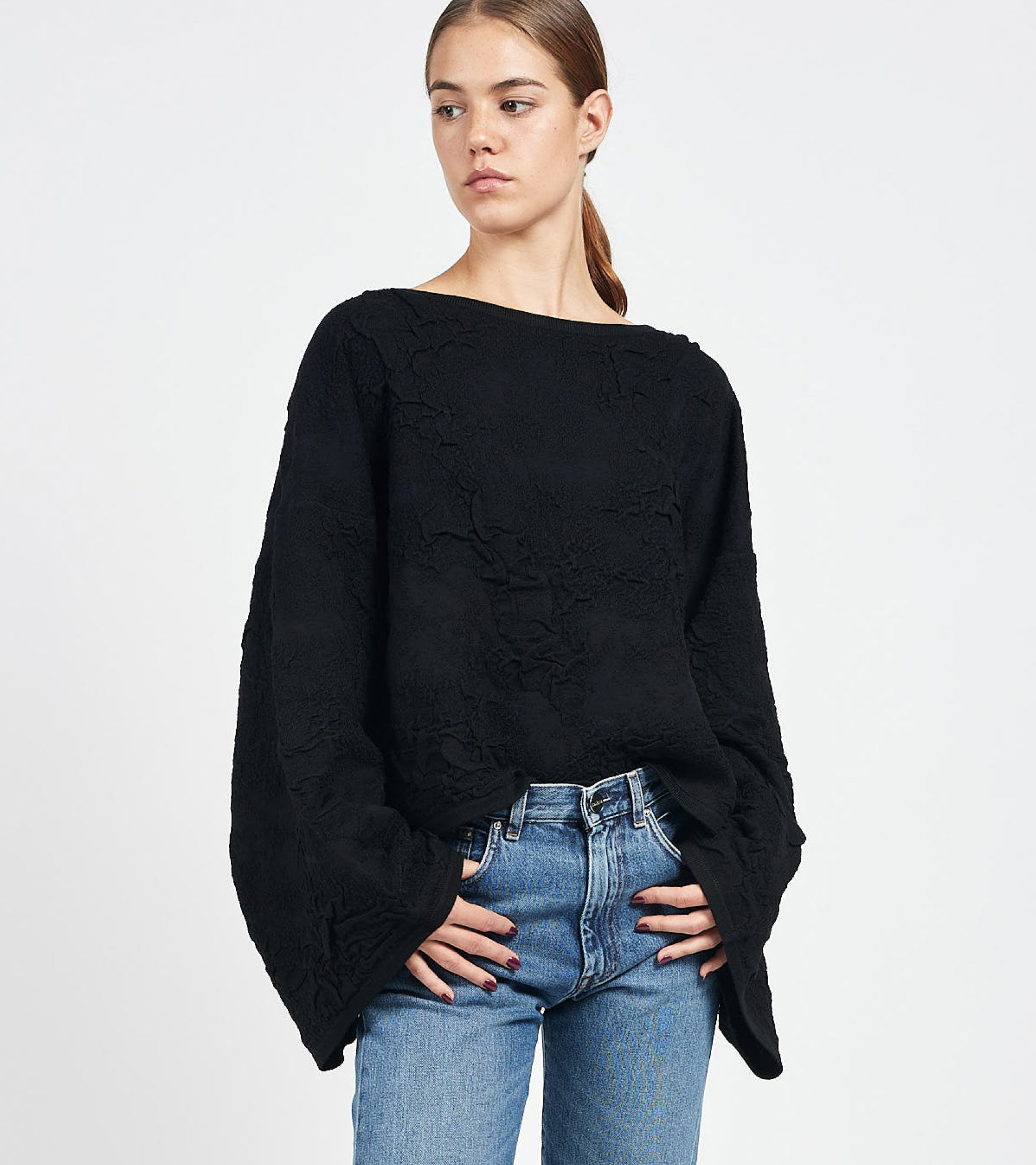 Shop women's designer sweaters and knitwear at Camargue.